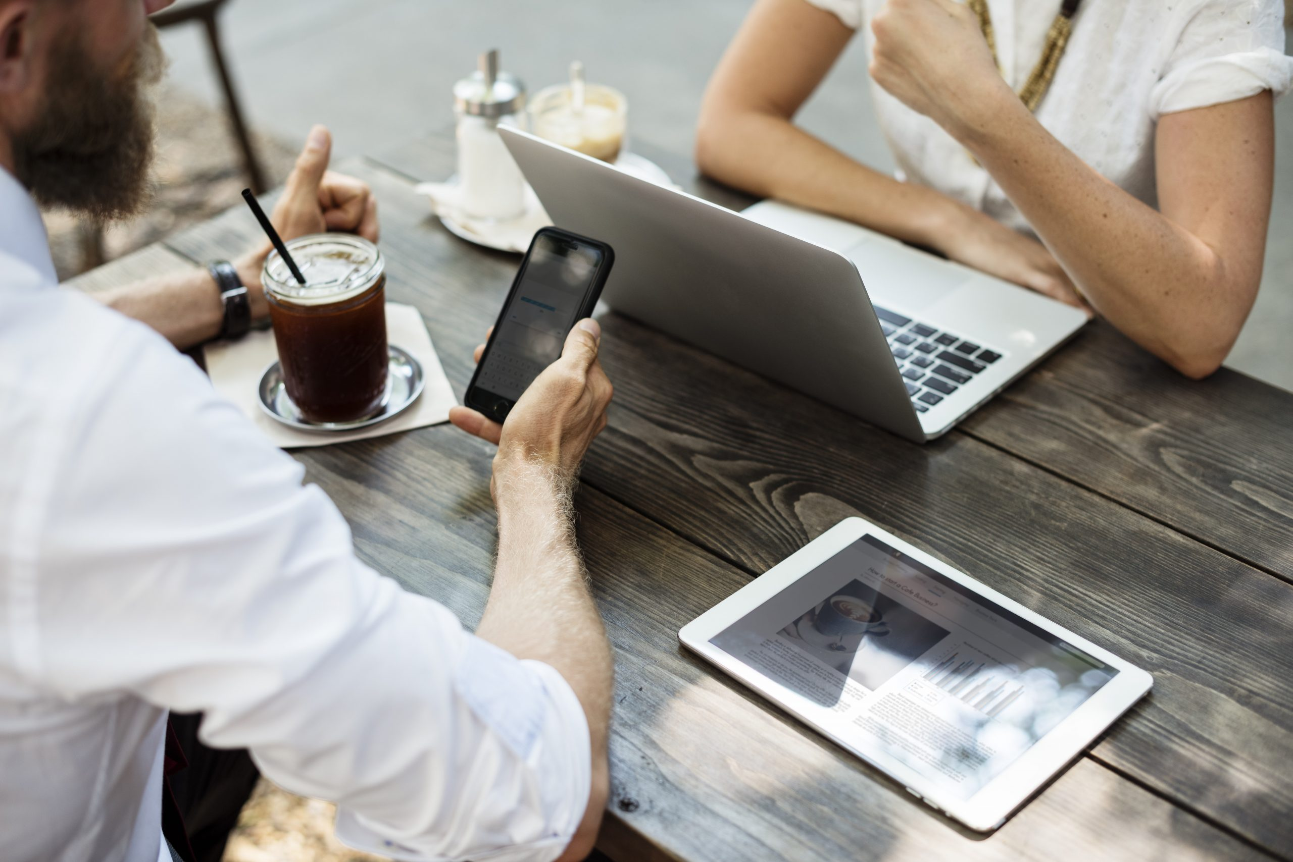 Business people hangout together at the coffee shop and discuss potential ways to recruit.