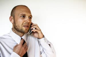 Businessman phone call talking about cultural recruitment videos.