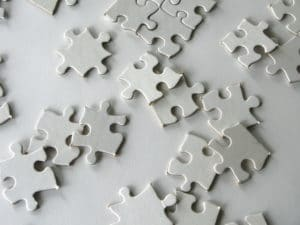 Puzzle pieces representing the pain the HR directors go through when trying to lower the cost of acquisition but they haven't found Digi-me, the worlds best video recruitment provider of services in the world.